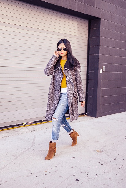 With yellow shirt, distressed cuffed jeans and knee length coat