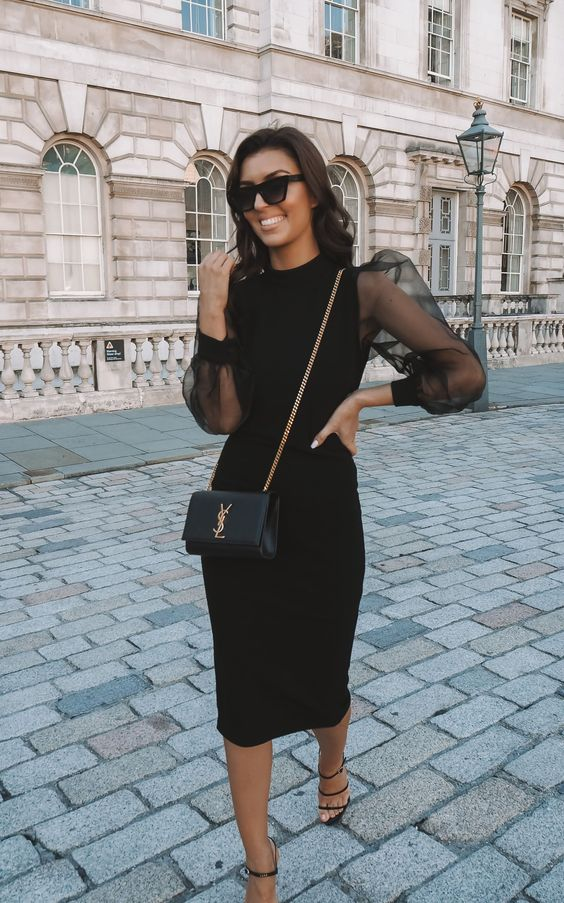 a black midi dress with sheer puffy sleeves, black shoes and a clutch for a formal party or a special occasion