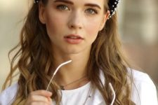 a black velvet headband with white pearls is a traditional and very refined accessory to add