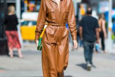 a brown leather maxi dress accented with a belt, colorful shoes and a bright green mini box clutch