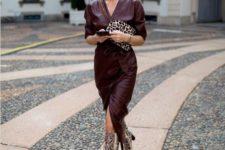 a burgundy wrap midi dress with long sleeves, an animal print bag and snakeskin print boots
