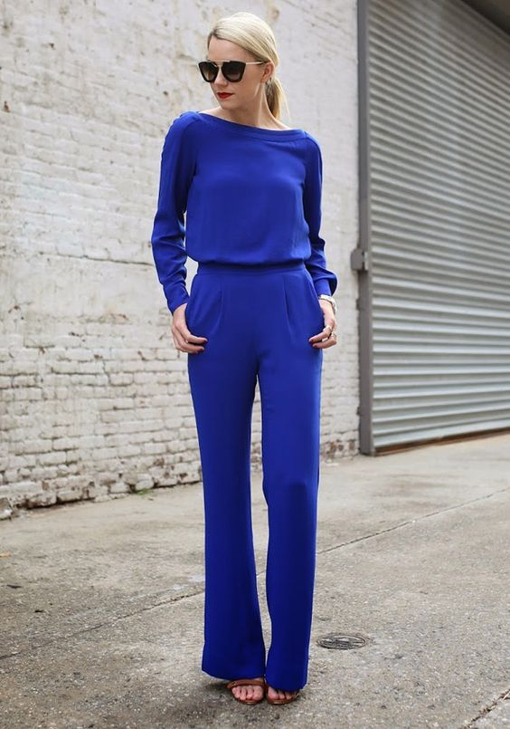a classic blue look with a sweater, pants, brown shoes for a fashion forward look