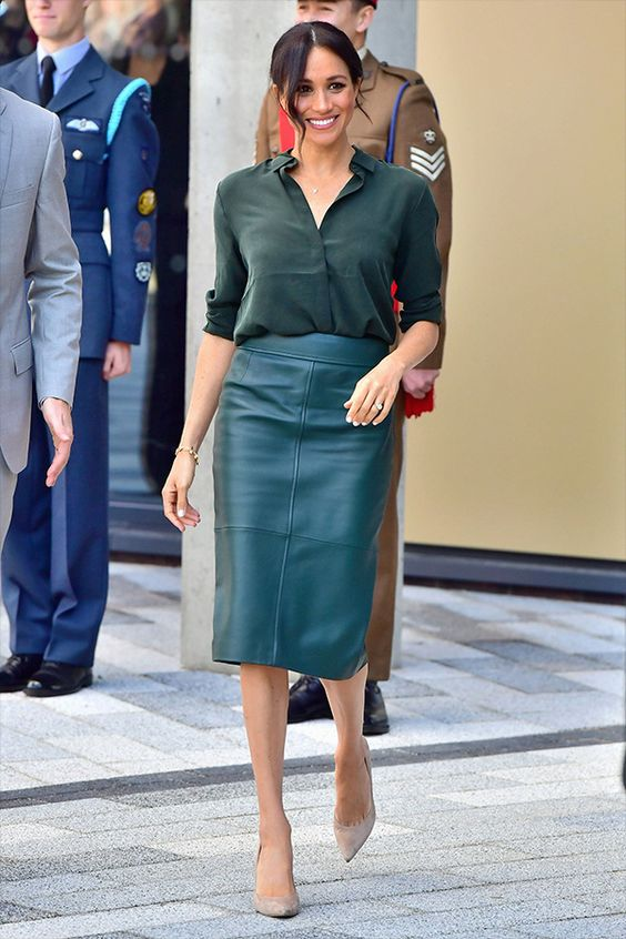a dark green shirt, a teal leather midi pencil skirt and blush shoes for a bold and statement look