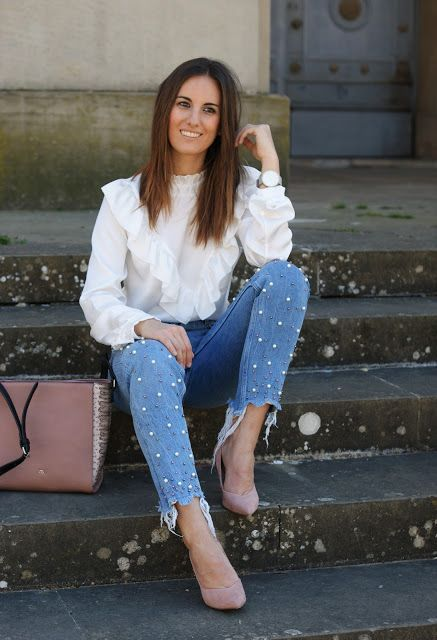 a girlish look with a white ruffle blouse, blue embellished jeans, blush shoes and a black bag