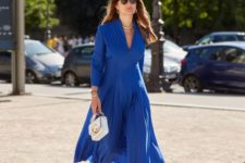a gorgeous look in classic blue for special occasion – a jumpsuit with a skirt, a white bag and white shoes