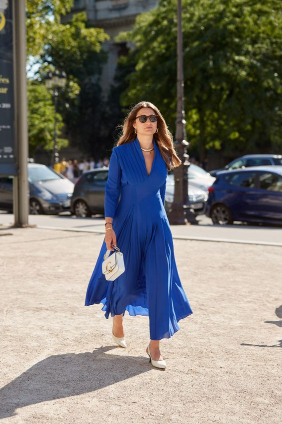 a gorgeous look in classic blue for special occasion   a jumpsuit with a skirt, a white bag and white shoes