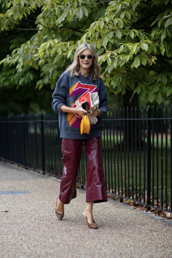 a grey sweater with colorful prints, burgundy leather culottes and leopard print shoes