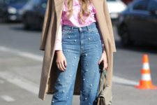 a pink ruffle blouse, pearl straight jeans, black shoes and a camel trench for the spring