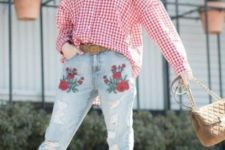 a red plaid shirt, light blue ripped and embroidered jeans and a brown belt for a bold look