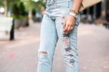 a silk purple top, whitewashed embroidered ripped jeans, lace up shoes and a comfy bag