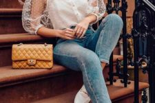 a trendy look with blue skinnies, white moccasins, a white polka dot blouse with puffy sleeves and a buttercup bag