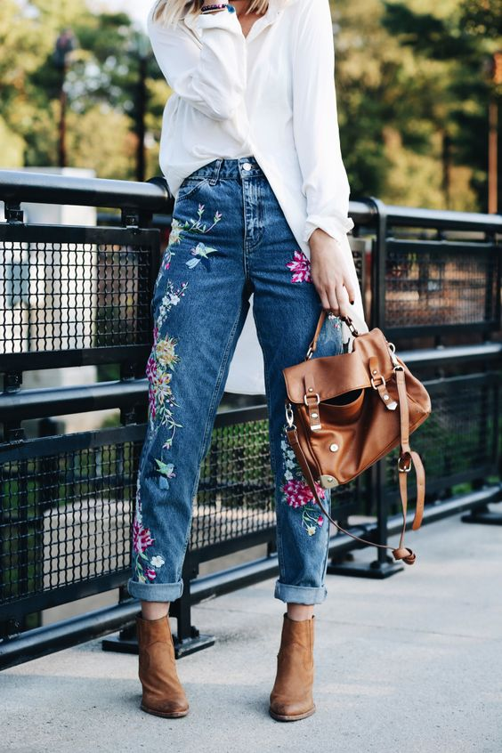 a white oversized shirt, blue embroidered jeans, brown booties and a bag for the fall