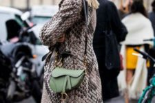 an emerald velvet padded headband and a grass-colored mini saddle bag for a fashion-forward person