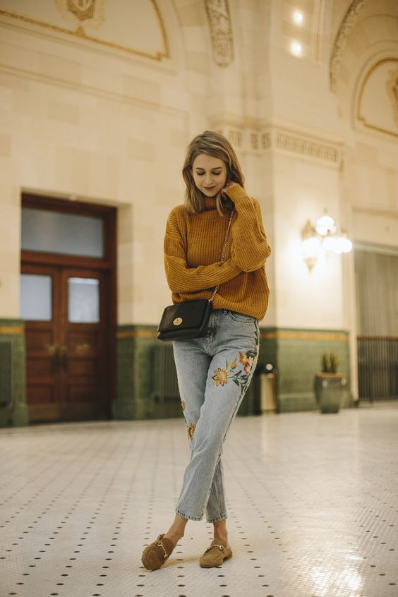 an oversized mustard sweater, whitewashed embroidered jeans, mustard slipper mules for the fall