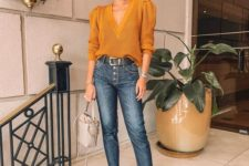 blue jeans, a mustard deep cut jumper, two tone shoes and an ivory bucket bag for now