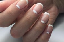 02 a classic French manicure completed with half moons that compose a double tip look