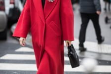 02 a monochromatic red and black look with a turtleneck, an oversized coat, sock boots and a black bag