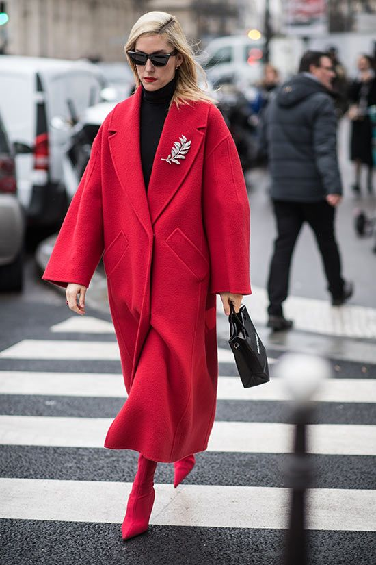 a monochromatic red and black look with a turtleneck, an oversized coat, sock boots and a black bag