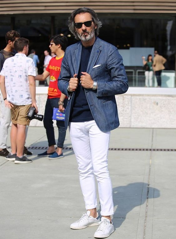a navy top, a blue blazer, white jeans and white sneakers for a pretty spring look