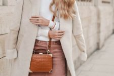 02 a white sweater, a pink corduroy skirt, a white shearling coat and an amber crossbody bag