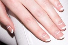 03 a creative double tip French manicure looks graphic and really modern and bold