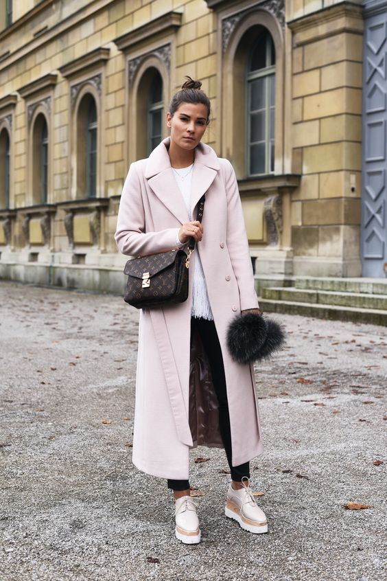a white top, black skinnies, white platform shoes, a blush coat and a brown printed bag