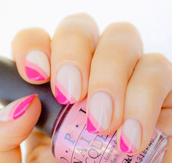 a diagonal double tip French manicure done in bold pink shades for those who love color