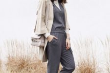 04 a minimalist outfit with a white turtleneck, a grey jumpsuit, white platform shoes, a grey blazer and a grey bag