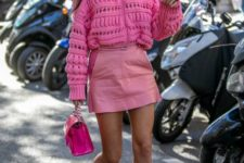 04 a pink oversized patterned sweater, a pink leather mini, matching boots and a hot pink bag