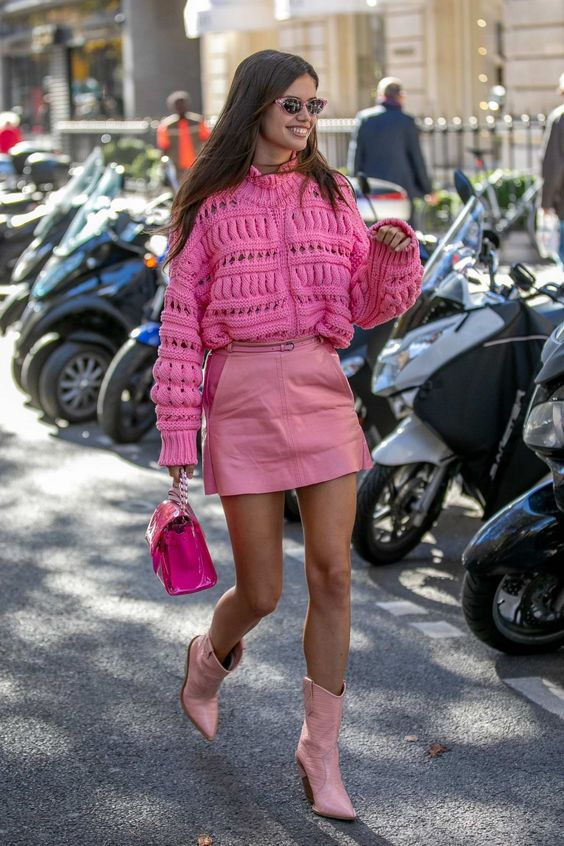 a pink oversized patterned sweater, a pink leather mini, matching boots and a hot pink bag