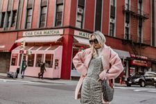04 a playful Valentine's Day look with a white turtleneck, a grey polka dot draped dress, a pink faux fur coat and white boots