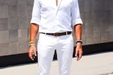 04 a summer look with a white shirt, white jeans, bright green sneakers and matching sunglasses