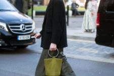 04 an oversized black blazer, green cargos, black high tops and an olive green bag with a round handle