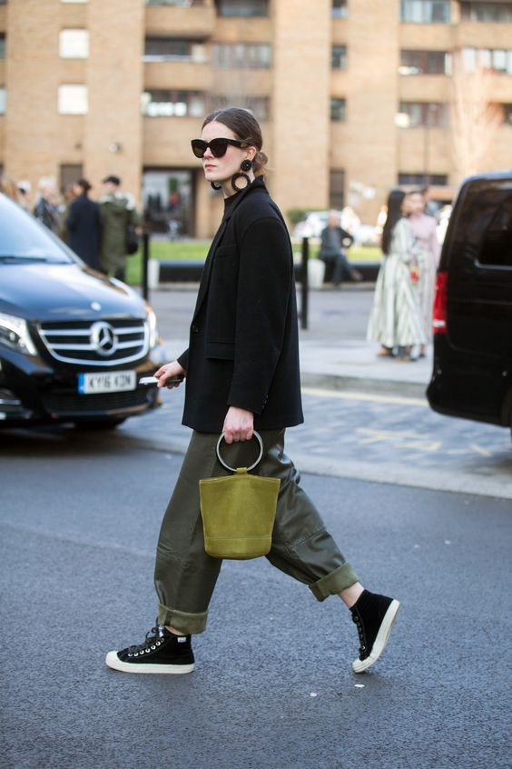 an oversized black blazer, green cargos, black high tops and an olive green bag with a round handle
