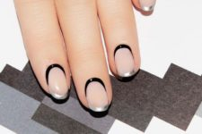 05 a double tip French manicure with silver and black tips that intersect going into each other