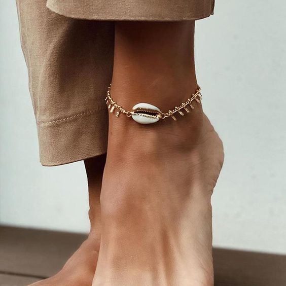 a gold chain anklet with a seashell is a mix of two hottest jewelry trends that are totally on now