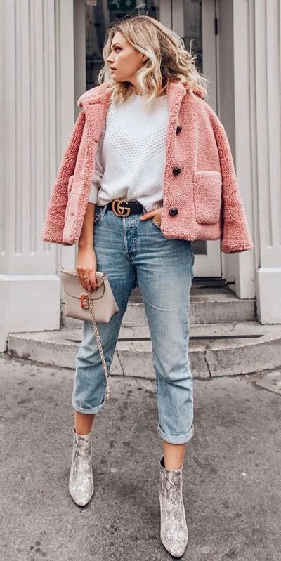 a white heart sweater, light blue jeans, snakeskin booties, a pink cropped faux fur coat, a neutral bag
