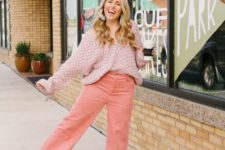 06 a blush patterned oversized sweater, corduroy pants in peachy pink, brown shoes and statement earrings