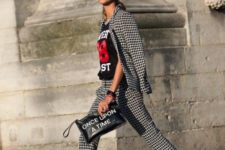 06 a printed black and white pantsuit, a printed tee, black platform shoes and a quirky clutch