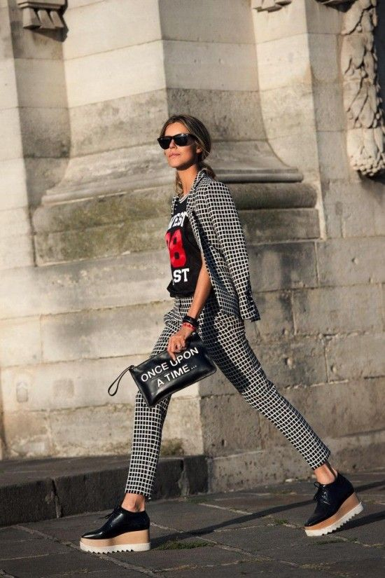 a printed black and white pantsuit, a printed tee, black platform shoes and a quirky clutch