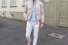 06 a spring look with a light blue shirt, a tan bomber jacket, white jeans and red sneakers is veyr comfy