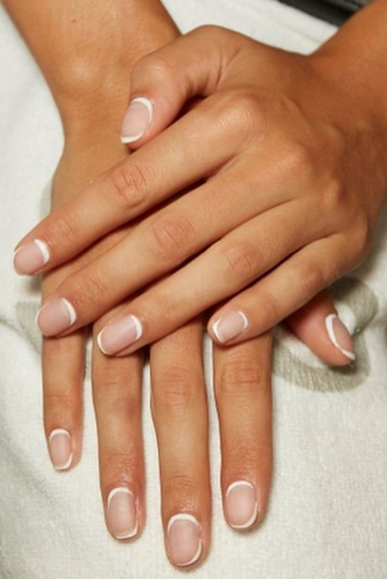a French manicure with a double tip is a cool idea to rock in 2020, a trendy way to wear French nails