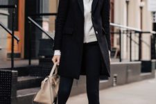 07 a sporty look with a grey hoodie, black leggings, a black coat, white sneakers and a neutral bag