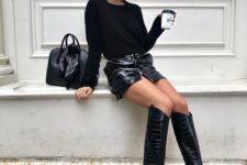07 a total black look with a top, leather mini, crocodile leather boots and a black for late winter