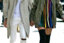 07 a white tee, white ripped jeans, black boots and an olive green trench for a bright spring look