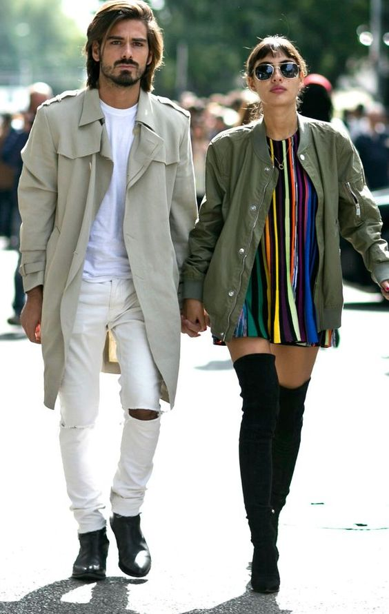 a white tee, white ripped jeans, black boots and an olive green trench for a bright spring look