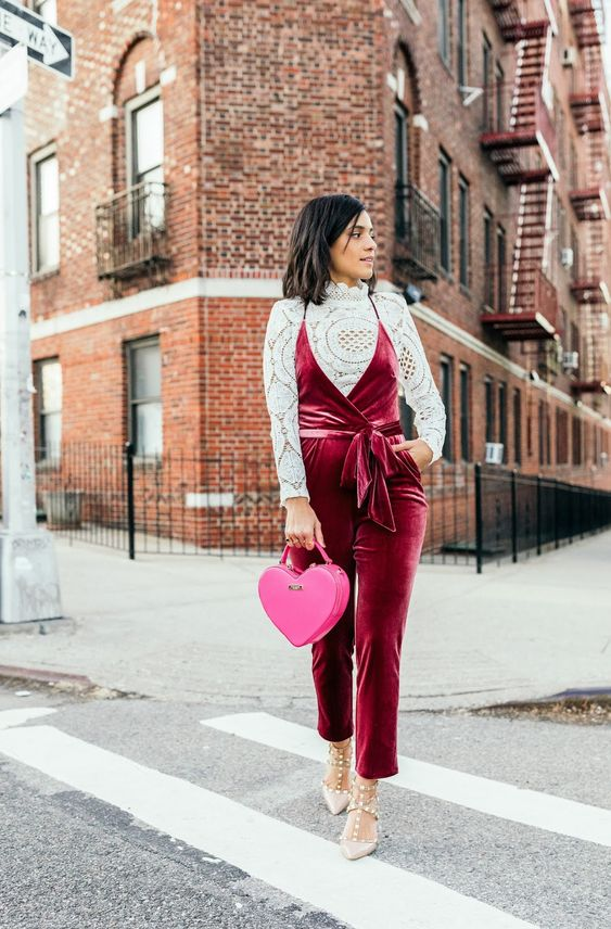 a crochet lace top, a burgundy velvet overall, nude spiked shoes, a pink heart-shaped bag