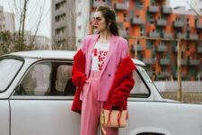08 a pink pantsuit with cropped pants, a printed tee, a red faux fur jacket and bright sneakers