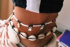 08 a shell and black bead anklet and a bead and star one to pair with can be worn with a sporty look