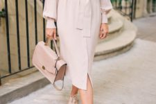 a blush midi shirtdress, a matching bag and matching sneakers for a spring work outfit